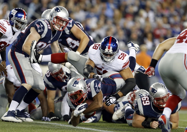Aug 29, 2013; Foxborough, MA, USA; New England Patriots running back George Winn (35) dives into the end zone for a touchdown against New York Giants middle linebacker Mark Herzlich (58) in the second quarter at Gillette Stadium. Mandatory Credit: David Butler II-USA TODAY Sports