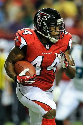 Aug 29, 2013; Atlanta, GA, USA; Atlanta Falcons fullback Jason Snelling (44) runs the ball in the second quarter against the Jacksonville Jaguars at the Georgia Dome. Mandatory Credit: Daniel Shirey-USA TODAY Sports