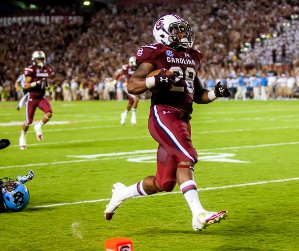 Aug 29, 2013; Columbia, SC, USA; South Carolina Gamecocks running back Mike Davis (28) rushes for a 75 yard touchdown against the North Carolina Tar Heels in the third quarter at Williams-Brice Stadium. Mandatory Credit: Jeff Blake-USA TODAY Sports