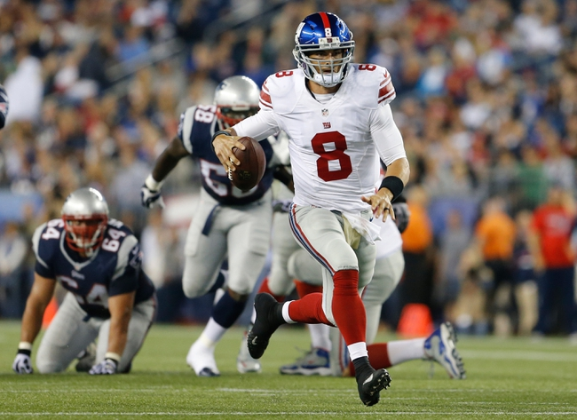 Aug 29, 2013; Foxborough, MA, USA;  New York Giants quarterback David Carr (8) runs the ball against the New England Patriots in the second quarter at Gillette Stadium. Mandatory Credit: David Butler II-USA TODAY Sports