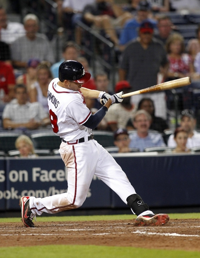Aug 29, 2013; Atlanta, GA, USA; Atlanta Braves shortstop Andrelton Simmons (19) hits a double against the Cleveland Indians in the seventh inning at Turner Field. Mandatory Credit: Brett Davis-USA TODAY Sports