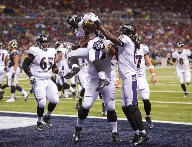 Aug 29, 2013; St. Louis, MO, USA; Baltimore Ravens running back Bobby Rainey (34) is congratulated after rushing for an 8 yard touchdown against the St. Louis Rams during the first half at the Edward Jones Dome. Mandatory Credit: Scott Rovak-USA TODAY Sports