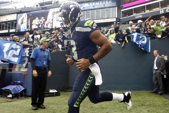 Aug 29, 2013; Seattle, WA, USA; Seattle Seahawks quarterback Russell Wilson (3) comes out to the field for pre game warmups against the Oakland Raiders at CenturyLink Field. Mandatory Credit: Joe Nicholson-USA TODAY Sports