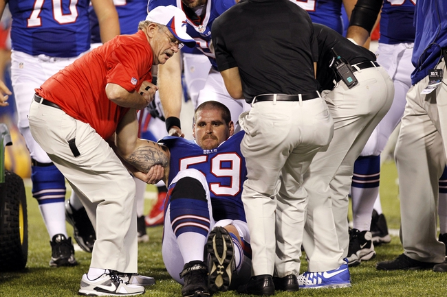 Aug 29, 2013; Orchard Park, NY, USA; Buffalo Bills center Doug Legursky (59) is lifted to a cart after being injured against the Detroit Lions during the second half at Ralph Wilson Stadium. Mandatory Credit: Kevin Hoffman-USA TODAY Sports