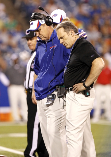 Aug 29, 2013; Orchard Park, NY, USA; Buffalo Bills head coach Doug Marrone and a team doctor look down at injured center Doug Legursky (not pictured) during the second half against the Detroit Lions at Ralph Wilson Stadium. Mandatory Credit: Kevin Hoffman-USA TODAY Sports