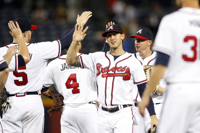 Aug 29, 2013; Atlanta, GA, USA; Atlanta Braves center fielder Jordan Schafer (17) celebrates a victory against the Cleveland Indians at Turner Field. The Braves defeated the Indians 3-1. Mandatory Credit: Brett Davis-USA TODAY Sports