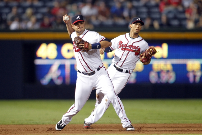 Aug 29, 2013; Atlanta, GA, USA; Atlanta Braves third baseman Paul Janish (4) throws a runner out at first against the Cleveland Indians in the ninth inning at Turner Field. The Braves defeated the Indians 3-1. Mandatory Credit: Brett Davis-USA TODAY Sports