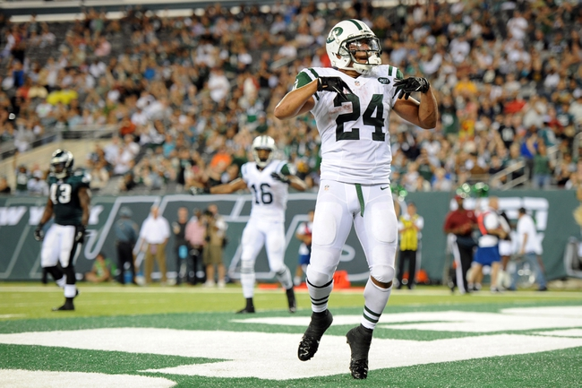 Aug 29, 2013; East Rutherford, NJ, USA; New York Jets running back Khalil Bell (24) celebrates a touchdown against the Philadelphia Eagles during the second half of a preseason game at Metlife Stadium. The Jets won 27-20. Mandatory Credit: Joe Camporeale-USA TODAY Sports