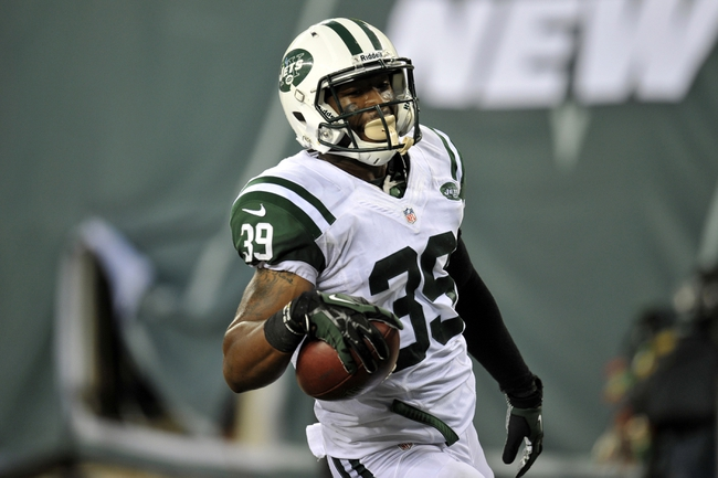 Aug 29, 2013; East Rutherford, NJ, USA; New York Jets strong safety Antonio Allen (39) returns an interception for a touchdown against the Philadelphia Eagles during the second half of a preseason game at Metlife Stadium. The Jets won 27-20. Mandatory Credit: Joe Camporeale-USA TODAY Sports