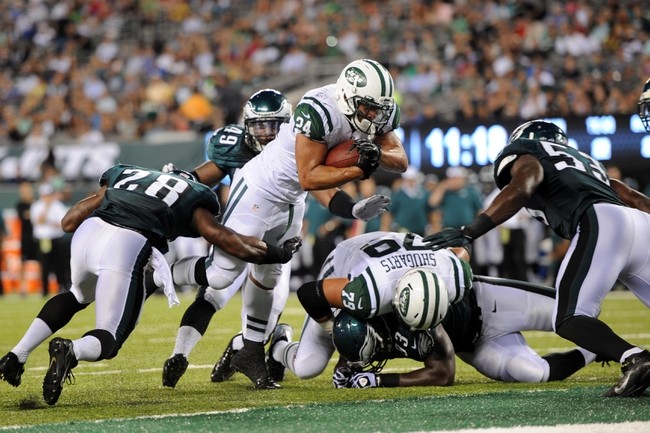 Aug 29, 2013; East Rutherford, NJ, USA; New York Jets running back Khalil Bell (24) scores a touchdown against the Philadelphia Eagles during the second half of a preseason game at Metlife Stadium. The Jets won 27-20. Mandatory Credit: Joe Camporeale-USA TODAY Sports