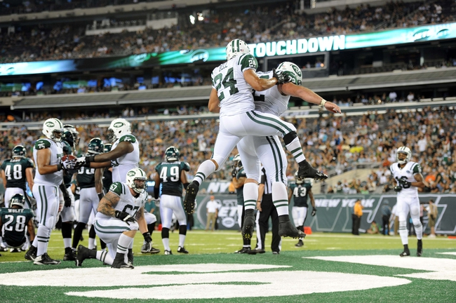 Aug 29, 2013; East Rutherford, NJ, USA; New York Jets running back Khalil Bell (24) and guard Caleb Schlauderaff (72) celebrate a touchdown against the Philadelphia Eagles during the second half of a preseason game at Metlife Stadium. The Jets won 27-20. Mandatory Credit: Joe Camporeale-USA TODAY Sports