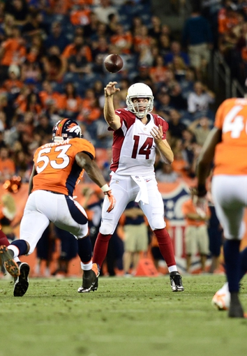 Aug 29, 2013; Denver, CO, USA; Arizona Cardinals quarterback Ryan Lindley (14) passes while under pressure from Denver Broncos linebacker Steven Johnson (53) during the second quarter of a preseason game at Sports Authority Field. Mandatory Credit: Ron Chenoy-USA TODAY Sports