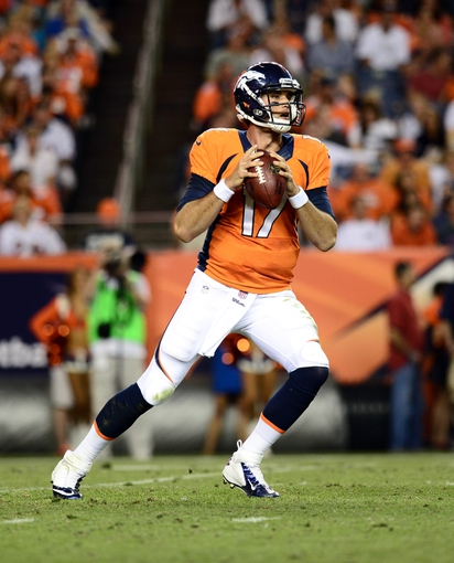 Aug 29, 2013; Denver, CO, USA; Denver Broncos quarterback Brock Osweiler (17) drops back to attempt a pass during the second quarter of a preseason game against the Arizona Cardinals at Sports Authority Field. Mandatory Credit: Ron Chenoy-USA TODAY Sports