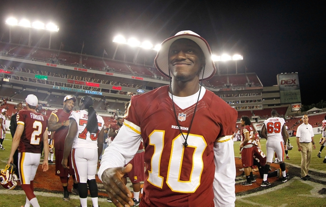 Aug 29, 2013; Tampa, FL, USA; Washington Redskins quarterback Robert Griffin III (10) smiles after the game against the Tampa Bay Buccaneers at Raymond James Stadium. The Redskins won 30-12. Mandatory Credit: Kim Klement-USA TODAY Sports