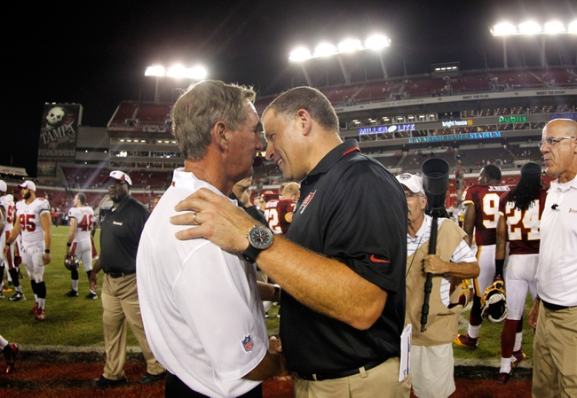 Aug 29, 2013; Tampa, FL, USA; Washington Redskins head coach Mike Shanahan and Tampa Bay Buccaneers head coach Greg Schiano greet each other after the game at Raymond James Stadium. The Redskins won 30-12. Mandatory Credit: Kim Klement-USA TODAY Sports