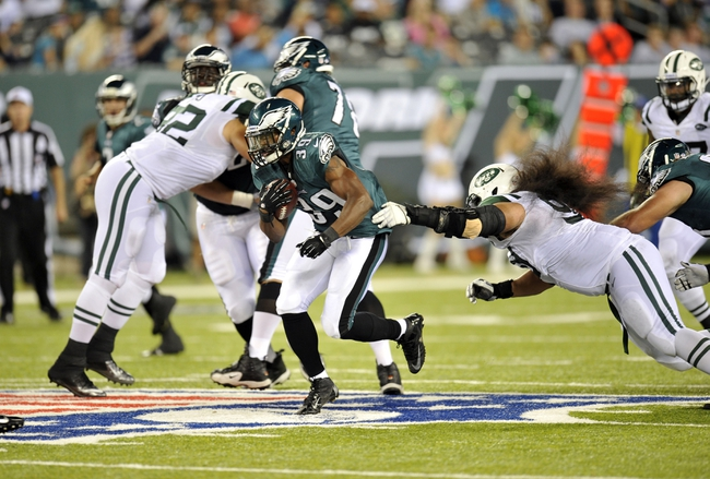 Aug 29, 2013; East Rutherford, NJ, USA; Philadelphia Eagles running back Matthew Tucker (39) runs against the New York Jets during the second half of a preseason game at Metlife Stadium. The Jets won 27-20. Mandatory Credit: Joe Camporeale-USA TODAY Sports