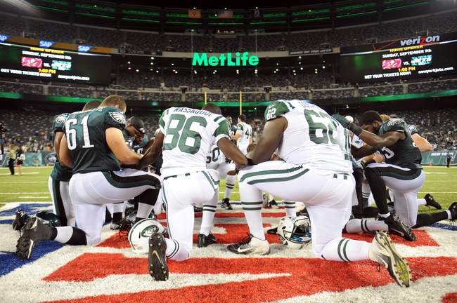 Aug 29, 2013; East Rutherford, NJ, USA; New York Jets and Philadelphia Eagles pray after the second half of a preseason game at Metlife Stadium. The Jets won 27-20. Mandatory Credit: Joe Camporeale-USA TODAY Sports