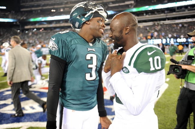 Aug 29, 2013; East Rutherford, NJ, USA; Philadelphia Eagles quarterback Dennis Dixon (3) and New York Jets wide receiver Santonio Holmes (10) talk after the second half of a preseason game at Metlife Stadium. The Jets won 27-20. Mandatory Credit: Joe Camporeale-USA TODAY Sports