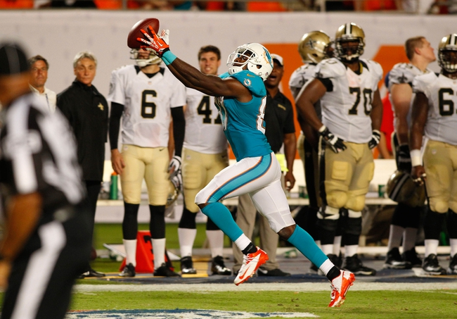 Aug 29, 2013; Miami Gardens, FL, USA; Miami Dolphins wide receiver Marvin McNutt (87) catches a touchdown pass against the New Orleans Saints in the fourth quarter at Sun Life Stadium. The Dolphins won 24-21.Mandatory Credit: Robert Mayer-USA TODAY Sports
