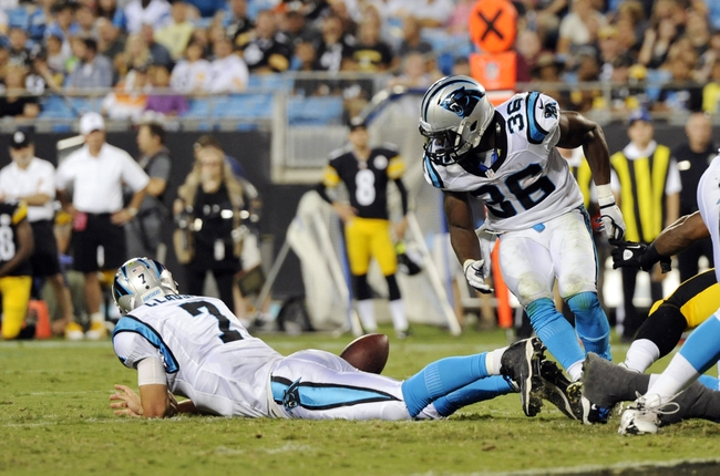 Aug 29, 2013; Charlotte, NC, USA; Carolina Panthers quarterback Jimmy Clausen (7) fumbles the ball as running back Armond Smith (36) looks to recover it  during the game against the Pittsburgh Steelers at Bank Of America Stadium. Panthers win 25-10. Mandatory Credit: Sam Sharpe-USA TODAY Sports