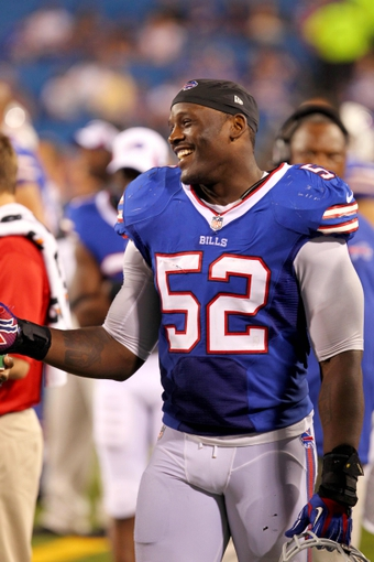 Aug 29, 2013; Orchard Park, NY, USA; Buffalo Bills outside linebacker Arthur Moats (52) on the sidelines during the second half against the Detroit Lions at Ralph Wilson Stadium.  The Lions won 35-13.   Mandatory Credit: Timothy T. Ludwig-USA TODAY Sports