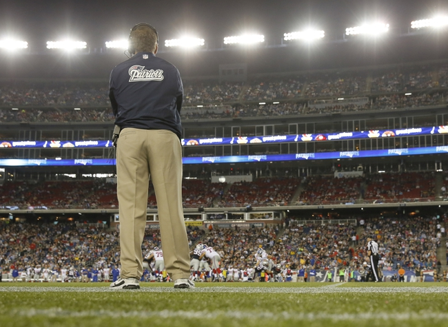 Aug 29, 2013; Foxborough, MA, USA; New England Patriots head coach Bill Belichick watches from the sideline as they take on the New York Giants in the fourth quarter at Gillette Stadium. Mandatory Credit: David Butler II-USA TODAY Sports