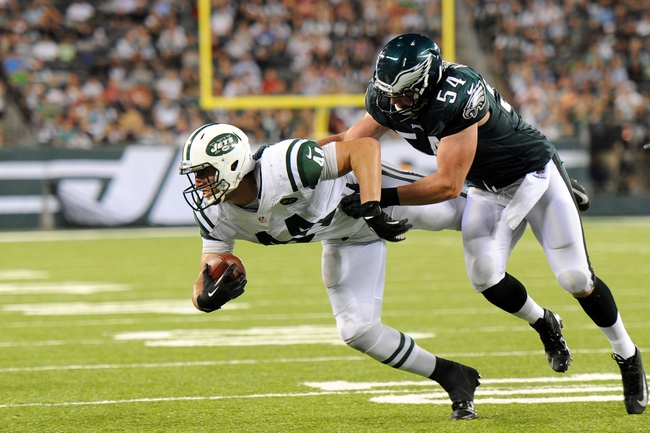 Aug 29, 2013; East Rutherford, NJ, USA; Philadelphia Eagles outside linebacker Jake Knott (54) tackles New York Jets tight end Chris Pantale (44) during the second half of a preseason game at Metlife Stadium. The Jets won 27-20. Mandatory Credit: Joe Camporeale-USA TODAY Sports