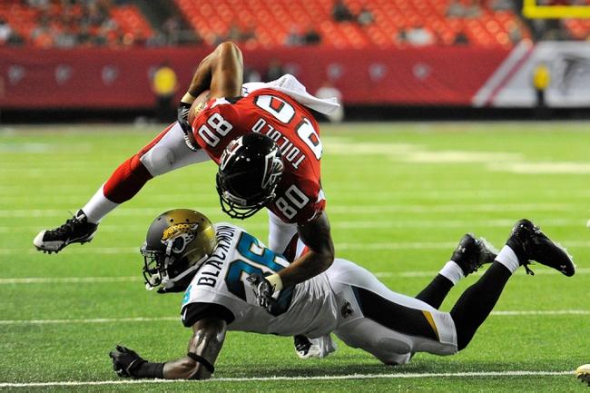 Aug 29, 2013; Atlanta, GA, USA; Atlanta Falcons tight end Levine Toilolo (80) runs over Jacksonville Jaguars defensive back Will Blackmon (36) during the fourth quarter at the Georgia Dome. The Jaguars defeated the Falcons 20-16. Mandatory Credit: Dale Zanine-USA TODAY Sports