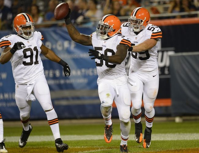 Aug 29, 2013; Chicago, IL, USA; Cleveland Browns outside linebacker James-Michael Johnson (50) reacts after intercepting a pass thrown by Chicago Bears quarterback Trent Edwards (not pictured) during the fourth quarter at Soldier Field. The Cleveland Browns defeat the Chicago Bears 18-16. Mandatory Credit: Mike DiNovo-USA TODAY Sports