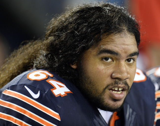 Aug 29, 2013; Chicago, IL, USA; Chicago Bears guard Derek Dennis (64) watches the game against the Cleveland Browns during the fourth quarter at Soldier Field. Mandatory Credit: Mike DiNovo-USA TODAY Sports
