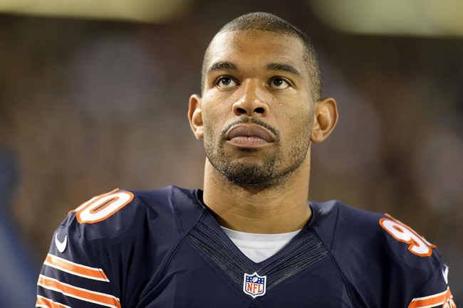 Aug 29, 2013; Chicago, IL, USA; Chicago Bears defensive end Julius Peppers (90) watches the game against the Cleveland Browns during the fourth quarter at Soldier Field. Mandatory Credit: Mike DiNovo-USA TODAY Sports