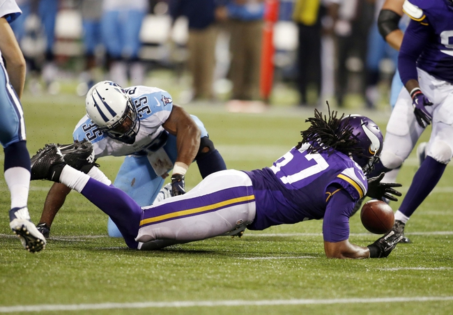 Aug 29, 2013; Minneapolis, MN, USA; Minnesota Vikings defensive end Collins Ukwu (67) recovers a fumble as Tennessee Titans running back Jalen Parmele (35) watches in the fourth quarter at Mall of America Field at H.H.H. Metrodome. Vikings win 24-23. Mandatory Credit: Bruce Kluckhohn-USA TODAY Sports