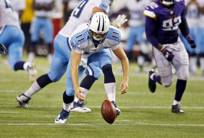 Aug 29, 2013; Minneapolis, MN, USA; Tennessee Titans quarterback Rusty Smith (11) chases the fumbled football that the Minnesota Vikings recover late in the fourth quarter at Mall of America Field at H.H.H. Metrodome. Vikings win 24-23. Mandatory Credit: Bruce Kluckhohn-USA TODAY Sports