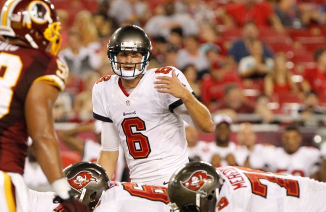 Aug 29, 2013; Tampa, FL, USA; Tampa Bay Buccaneers quarterback Dan Orlovsky (6) calls a play at the line of scrimmage against the Washington Redskins during the second half at Raymond James Stadium. The Redskins won 30-12. Mandatory Credit: Kim Klement-USA TODAY Sports