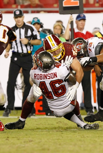 Aug 29, 2013; Tampa, FL, USA; Washington Redskins inside linebacker Will Compton (46) tackles Tampa Bay Buccaneers running back Mason Robinson (46) during the second half at Raymond James Stadium. The Redskins won 30-12. Mandatory Credit: Kim Klement-USA TODAY Sports
