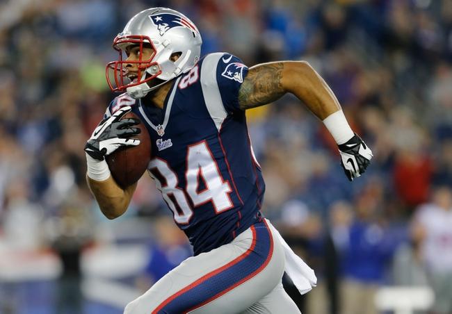 Aug 29, 2013; Foxborough, MA, USA; New England Patriots wide receiver Quentin Sims (84) makes a catch and runs the ball for a touchdown against the New York Giants in the fourth quarter at Gillette Stadium. Mandatory Credit: David Butler II-USA TODAY Sports