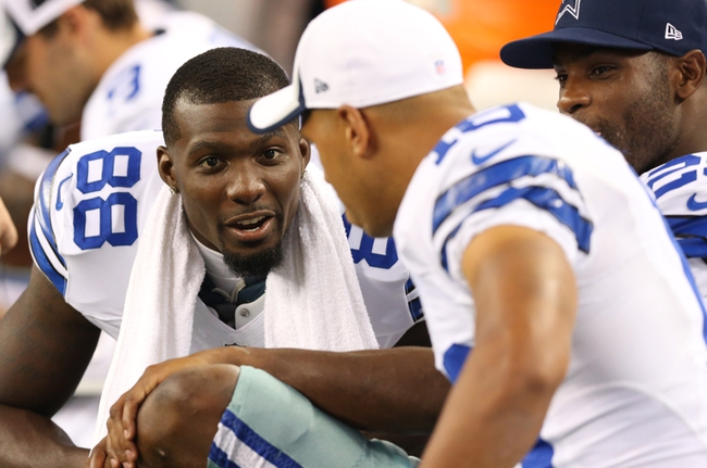 Aug 29, 2013; Arlington, TX, USA; Dallas Cowboys receiver Dez Bryant (88) talks with receiver Miles Austin (19) during the game against the Houston Texans at AT&T Stadium. Mandatory Credit: Matthew Emmons-USA TODAY Sports