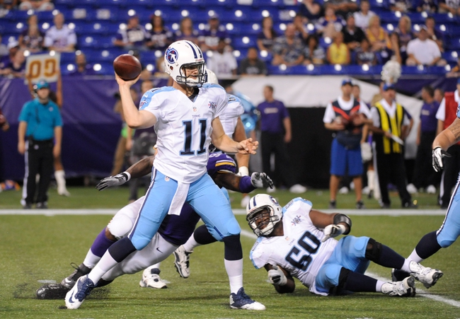 Aug 29, 2013; Minneapolis, MN, USA;  Tennessee Titans quarterback Rusty Smith (11) completes a pass against the Minnesota Vikings at the Metrodome. The Vikings won 24-23.  Mandatory Credit: Marilyn Indahl-USA TODAY Sports