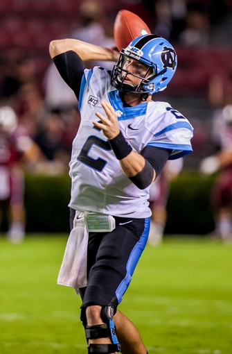 Aug 29, 2013; Columbia, SC, USA; North Carolina Tar Heels quarterback Bryn Renner (2) warms up following a weather delay in the fourth quarter against the South Carolina Gamecocks at Williams-Brice Stadium. Mandatory Credit: Jeff Blake-USA TODAY Sports