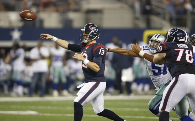 Aug 29, 2013; Arlington, TX, USA; Houston Texans quarterback T.J. Yates (13) throws a pass during the fourth quarter of the game against the Dallas Cowboys at AT&T Stadium. Houston beat Dallas 24-6. Mandatory Credit: Tim Heitman-USA TODAY Sports