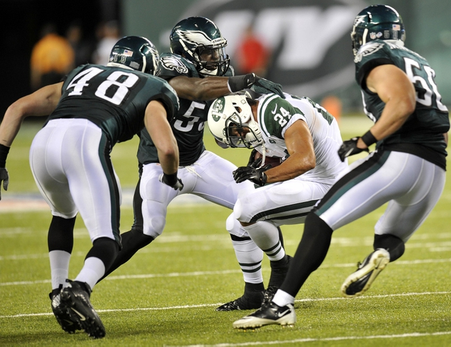 Aug 29, 2013; East Rutherford, NJ, USA; Philadelphia Eagles linebacker Emmanuel Acho (53) tackles New York Jets running back John Griffin (24) during the second half of a preseason game at Metlife Stadium. The Jets won 27-20. Mandatory Credit: Joe Camporeale-USA TODAY Sports