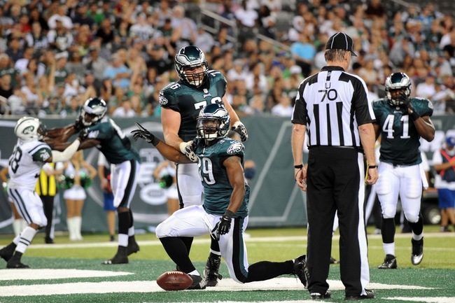 Aug 29, 2013; East Rutherford, NJ, USA; Philadelphia Eagles running back Matthew Tucker (39) scores a two point conversion against the New York Jets during the second half of a preseason game at Metlife Stadium. The Jets won 27-20. Mandatory Credit: Joe Camporeale-USA TODAY Sports