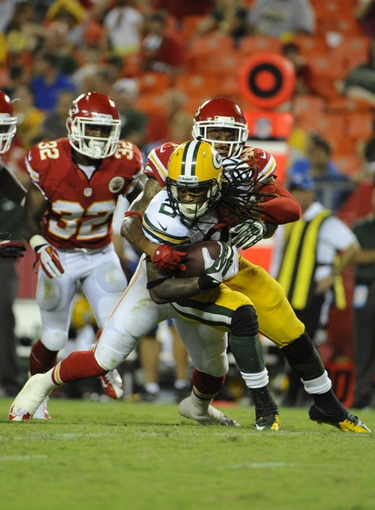 Aug 29, 2013; Kansas City, MO, USA; Kansas City Chiefs free safety Bradley McDougald (48) tackles Green Bay Packers running back Alex Green (20) in the second half at Arrowhead Stadium. Kansas City won the game 30-8. Mandatory Credit: John Rieger-USA TODAY Sports`