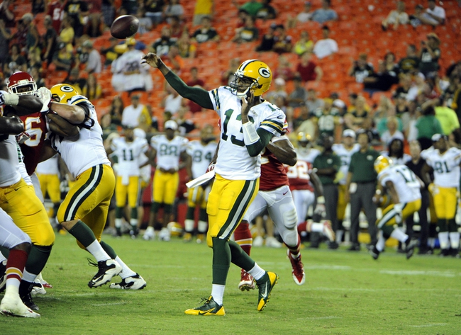Aug 29, 2013; Kansas City, MO, USA; Green Bay Packers quarterback Vince Young (13) throws a pass against the Kansas City Chiefs in the second half at Arrowhead Stadium. Kansas City won the game 30-8. Mandatory Credit: John Rieger-USA TODAY Sports`