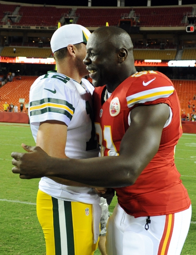 Aug 29, 2013; Kansas City, MO, USA; Kansas City Chiefs linebacker Tamba Hali (91) talks to Green Bay Packers quarterback Aaron Rodgers (12) after the game at Arrowhead Stadium. Kansas City won the game 30-8. Mandatory Credit: John Rieger-USA TODAY Sports