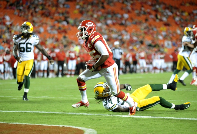 Aug 29, 2013; Kansas City, MO, USA; Kansas City Chiefs wide receiver Frankie Hammond (85) runs in for a touchdown as Green Bay Packers defensive back Brandon Smith (34) can't make the tackle during the second half of the game at Arrowhead Stadium. The Chiefs won 30-8. Mandatory Credit: Denny Medley-USA TODAY Sports