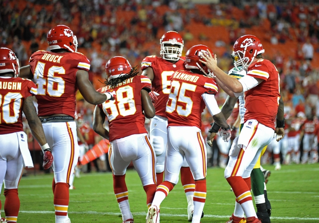 Aug 29, 2013; Kansas City, MO, USA; Kansas City Chiefs wide receiver Frankie Hammond (85) is congratulated by quarterback Tyler Bray (9) after scoring a touchdown during the second half of the game against the Green Bay Packers at Arrowhead Stadium. The Chiefs won 30-8. Mandatory Credit: Denny Medley-USA TODAY Sports