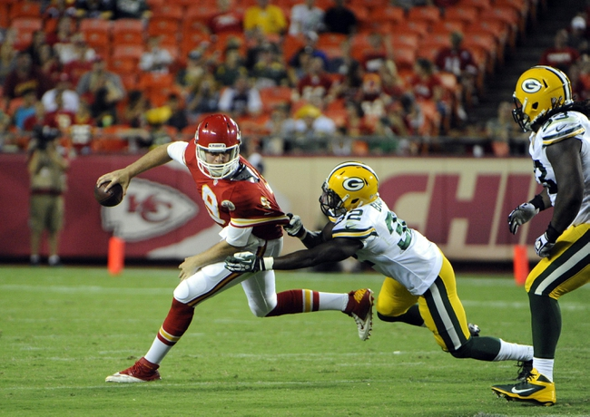 Aug 29, 2013; Kansas City Chiefs quarterback Tyler Bray (9) is sacked by Green Bay Packers defensive back Chris Banjo (32) in the second half at Arrowhead Stadium. Kansas City won the game 30-8. Mandatory Credit: John Rieger-USA TODAY Sports`