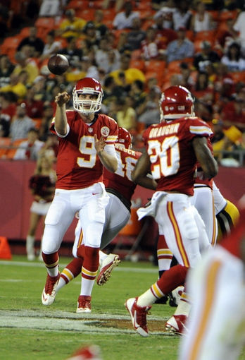 Aug 29, 2013; Kansas City Chiefs quarterback Tyler Bray (9) throws a pass to running back Shaun Draughn (20) against the Green Bay Packers in the second half at Arrowhead Stadium. Kansas City won the game 30-8. Mandatory Credit: John Rieger-USA TODAY Sports`