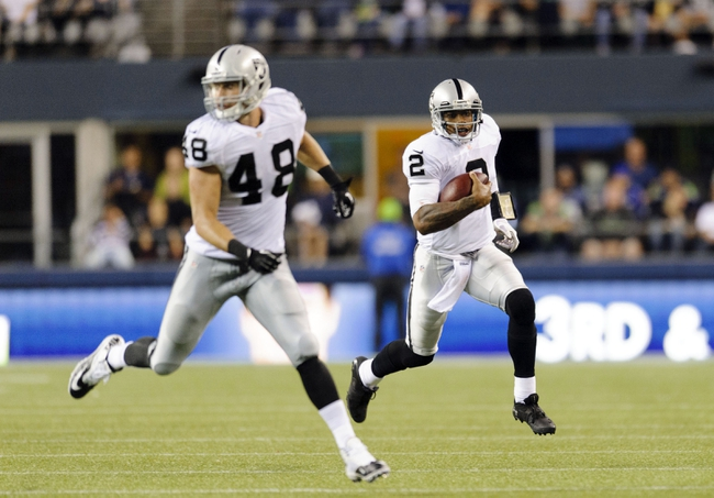 Aug 29, 2013; Seattle, WA, USA; Oakland Raiders quarterback Terrelle Pryor (2) runs with the ball while tight end Jeron Mastrud (48) blocks during the 1st half at CenturyLink Field. Mandatory Credit: Steven Bisig-USA TODAY Sports